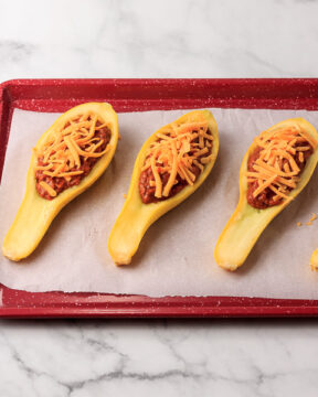 Sprinkle chili with cheese.