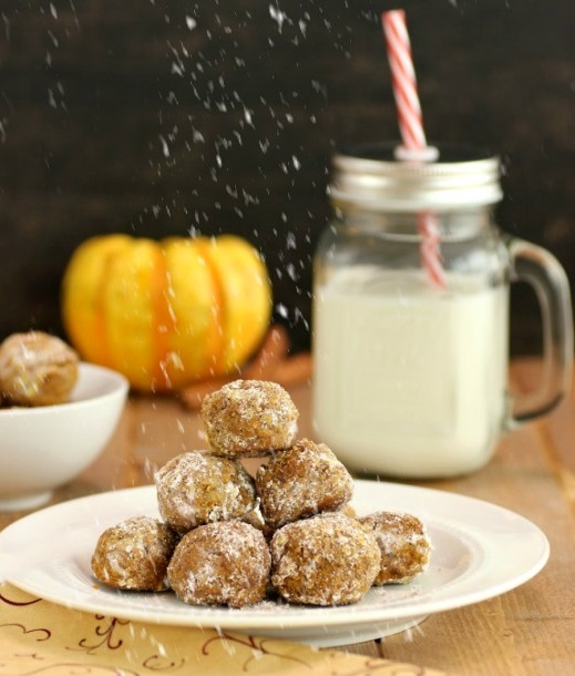 Pumpkin spice cookie balls with powdered coating.