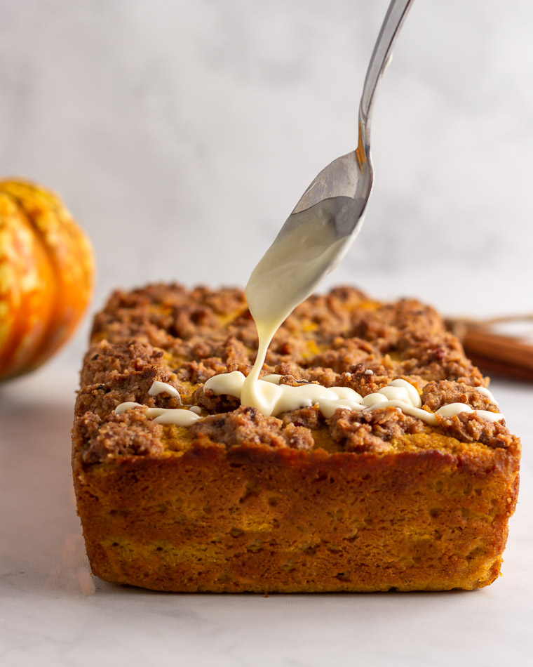 Drizzling icing on keto pumpkin bread streusel