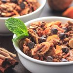 Crunchy low carb granola with sugar-free chocolate chips and orange accents.