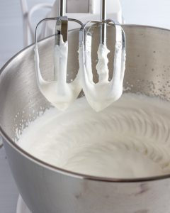 Whipping cream to firm peaks.
