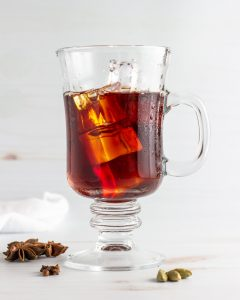 Adding ice and pouring tea.