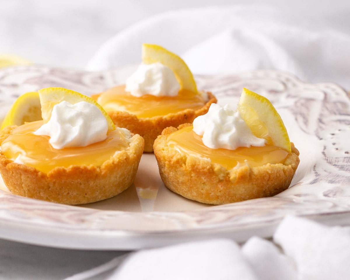 Three keto lemon mini tarts.