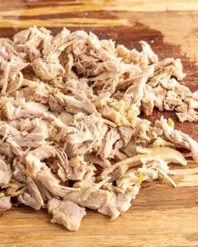 Add shredded chicken to soup.