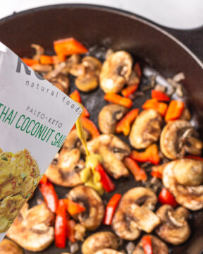 Adding sauce to the pan of veggies