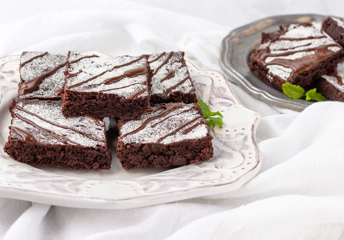A plate of chocolaty keto brownies.