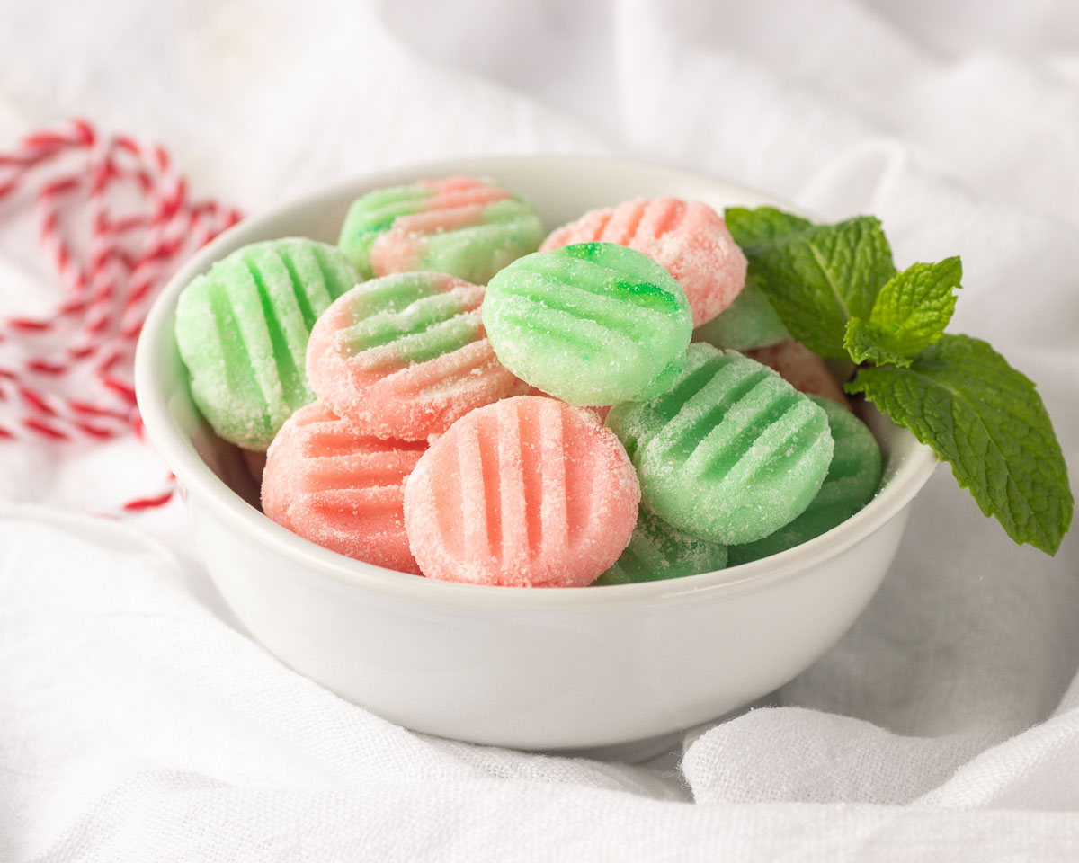A bowl of pink & green mints.