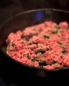 Brown ground beef.