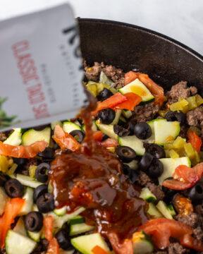 Add sauce and veggies to pan.