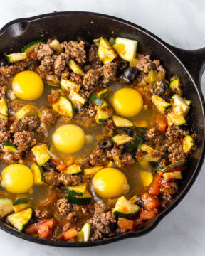 Add eggs to skillet.