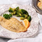 keto parmesan breaded crusted fish with broccoli.