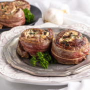 Two flank stea rolls stuffed with cheese & spinach.
