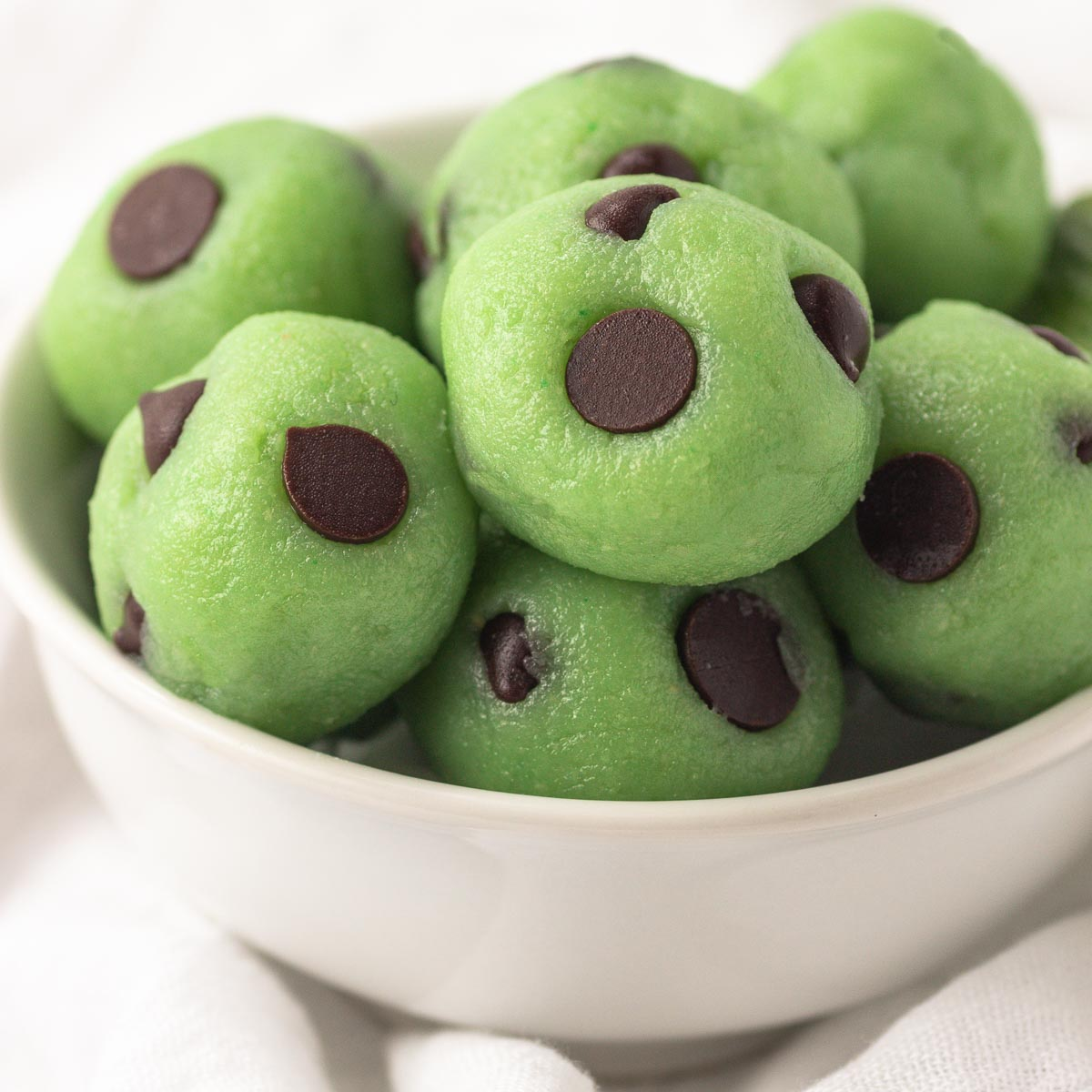 A bowl of keto mint chocolate chip cheesecake bites.