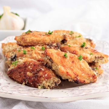 A plate of garlic parmesan chicken wings.