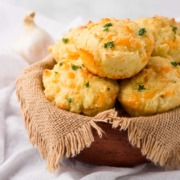A basket of low carb cheddar garlic biscuits.