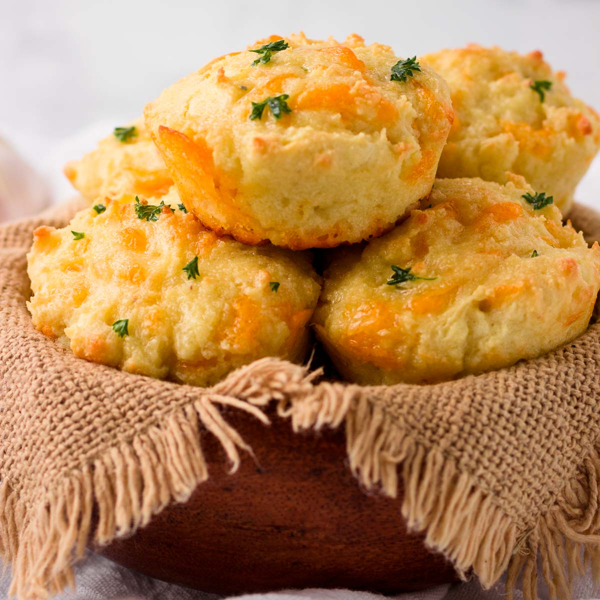 A basket of cheesy garlic biscuits that are low carb.