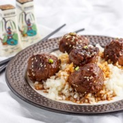 Meatballs and cauliflower rice in teriyaki sauce.
