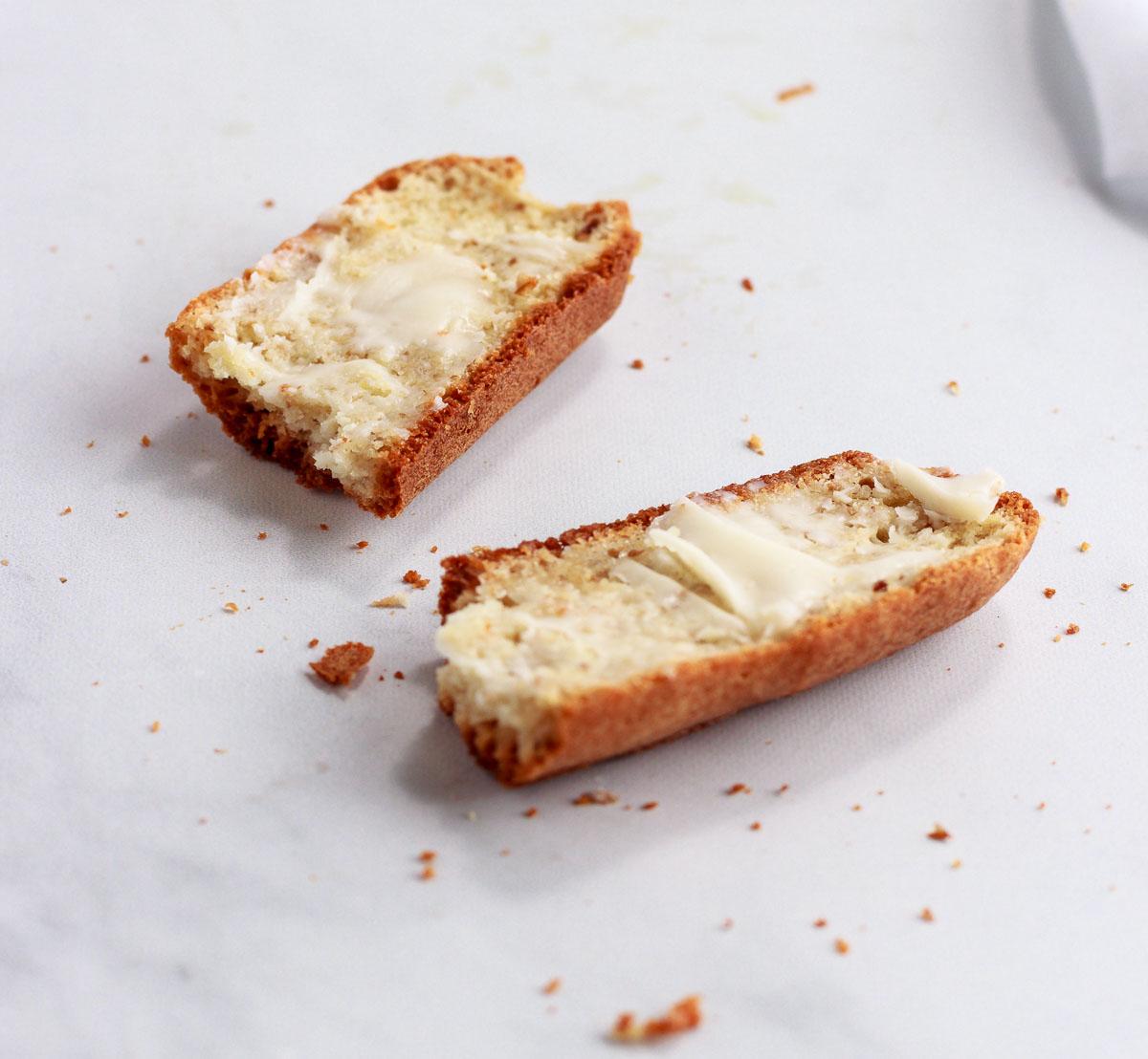 A slice of crusty bread broken into two pieces