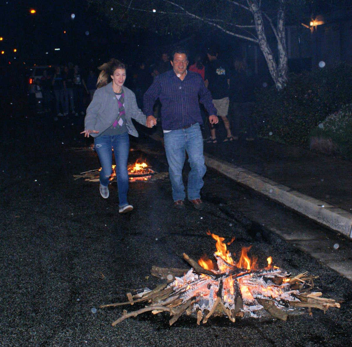 People jumping over small fires for Chahar Shanbeh Soori.
