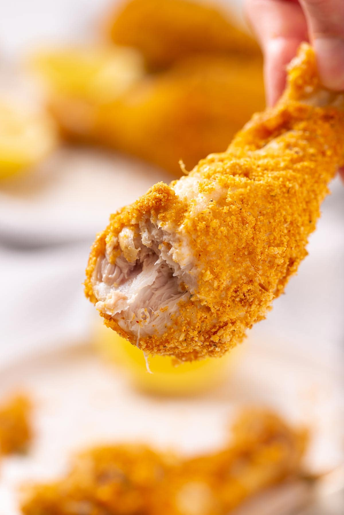 A chicken drumstick with a bite in it.